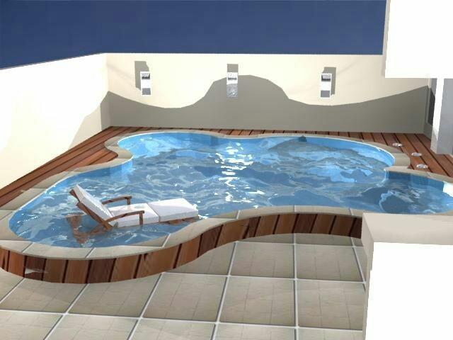42 – Área de lazer clean, com piscina em alvenaria e deck