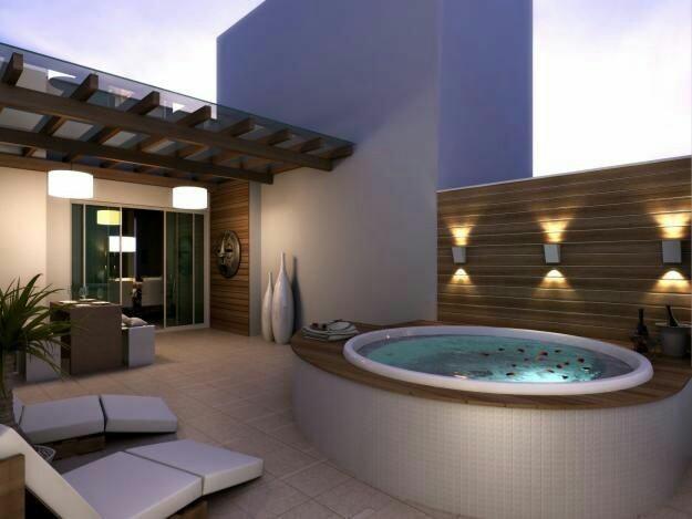 62– Área de lazer com piscina ovalada em fibra de vidro, borda em madeira