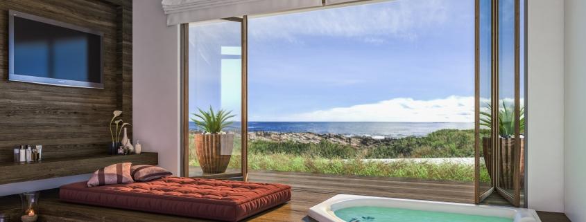 As banheiras de canto são muito versáteis e por isto podem ser instaladas em quartos, como nesta ideia.